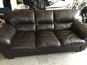 Brown faux leather sofa (demensions 7ft x 3ft x 3ft - L x D x H)
