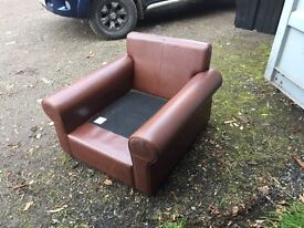 Brown leather arm chair .