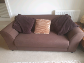 Chocolate brown sofa with optional free of charge cushions