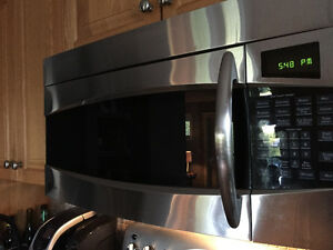 Over the range (OTR) stainless steel microwave