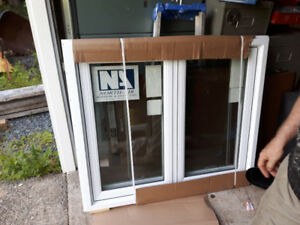 BRAND NEW double casement window 47``wide, 39 3/4``high