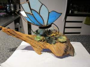 Stained glass art piece on drift wood.