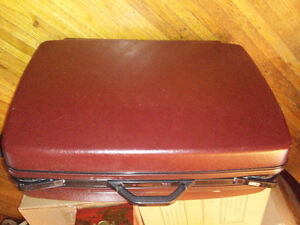 Vintage hard covered suitcase