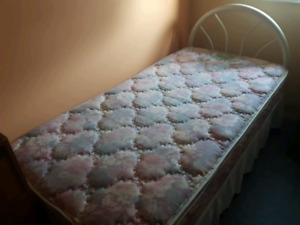 Single Bed with frame and box spring.