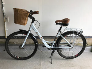 Woman's bicycle, white frame with brown wicker basket