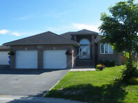 NEW PRICE Beautiful Home in Dominion Parc with 2 heated garages!