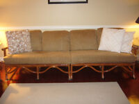 TWO  RATTAN CHENILLLE COVERED SOFAS PLUS CHAIR AND OTTOMAN