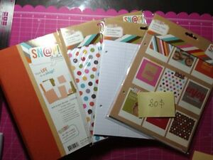 Scrapbooking items: smash books, paper pads