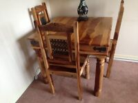 Solid sheesham dining table and 4 chairs