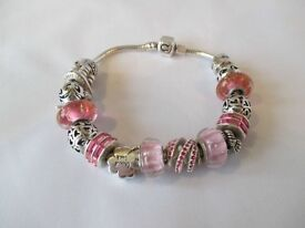 CHAMILIA STERLING SILVER READY MADE CHARM BRACELET WITH 17 CHARMS *ex display*