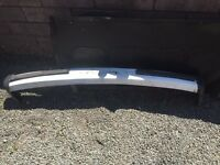 Vw t25 from bumper in white with black end caps and bump strips