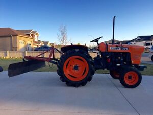 Kubota L175 diesel tractor with three point hitch and blade