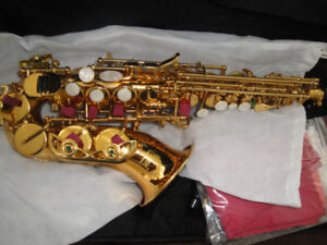 SOPRANO SAXOPHONE  BRAND NEW AND PINK ALTO SAX  NEW $400 EACH