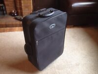 Small trolley suitcase.