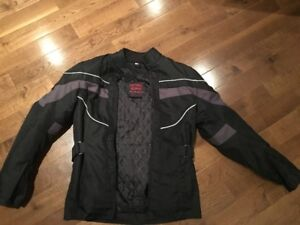 Ladies Motorcycle jacket with protective inserts, size XS