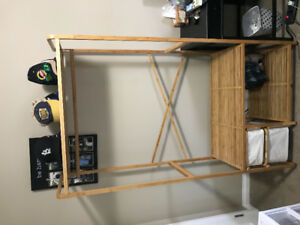 Clothes rack with bin storage