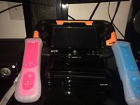 Console Wii U avec Game pad + 2 manettes Wii + 4 jeux à vendre