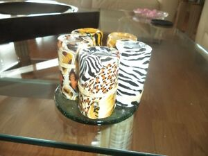 5 animal print candles plus another that goes with the look.