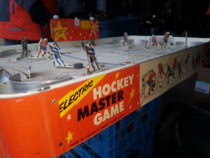 Antique Garage sale..hockey ..tins..signs..retro couch