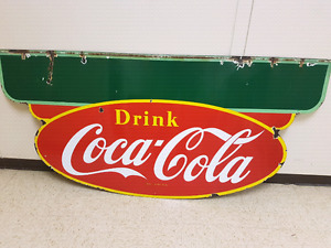 Large store front 1950 Coke sign