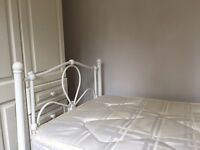 White metal single bed flower bed frame