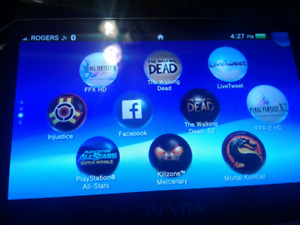 PS Vita emaculate condition games and charger 3 memory cards