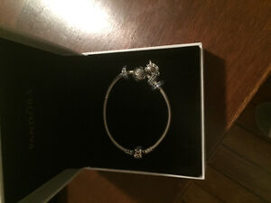 Brand New Pandora Bracelet with four charms for sale