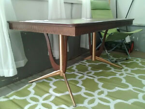 Retro table with attached pop-up leaf.