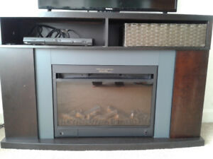 Combination ELECTRIC FIREPLACE /TV STAND with remote.