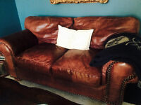 Two Brown Leather Couches