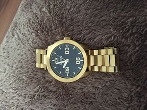 Selling Nixon gold watch mint condition  London Ontario image 4