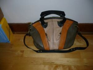 Brand new Oryanny leather purse.