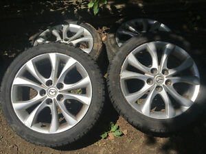 Mazda rims and tires 205/50/17  ,good shape only 250