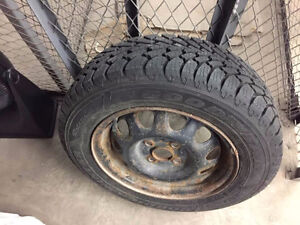Selling barely used set of 4 Goodyear Nordic tires (185/65R14)