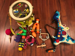 Lot of baby toys - Musical instruments, walker, train... oh my!