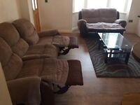 Brown fabric and leather 3 & 2 seater reclining sofas