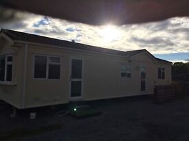 Rough cast mobile Home 2 bed
