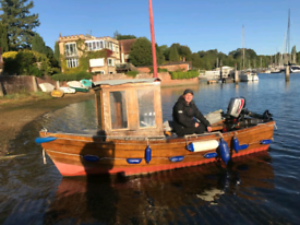 SOLD PENDING COLLECTION Clinker Style Boat With engine and trailer