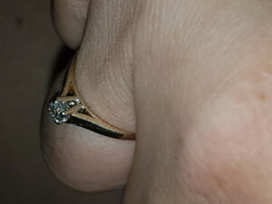 Diamond solitaire engagement ring.