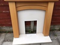 Wooden fireplace surround, back board and mock stone hearth