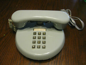 Antique bell rotary (dial) phone and round touch tone phone