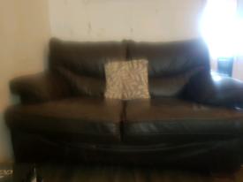 Dark brown 2 seater brown leather sofa.