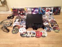 BRAND NEW PS3, 2 controllers and GAMES