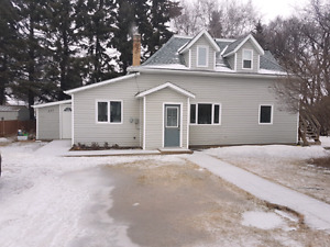 2 bedroom house w/ additional 1 bdrm suite for sale in Neepawa