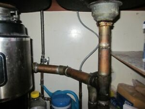 LICENSED PLUMBER NEEDED: KITCHEN LEAK UNDER SINK