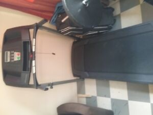 TREADMILL Worth 650 NEW for 200 used!! power surge included