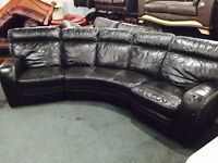 As new black curved recliner leather sofa