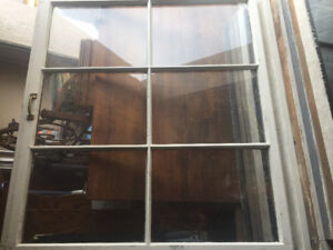 Wood Frame windows made in 1873. Original glass and frames
