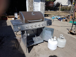 Bbq and two tanks