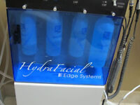 Hydra Facial MD machine.... { 3 Treatments for $360 } ......